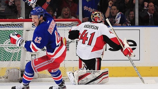 New York Rangers' Artem Anisimov (42) celebrates a goal by Ryan Callahan as Ottawa Senators goalie Craig Anderson (41) looks away during the first period of Game 1 of a first-round NHL hockey playoff series, Thursday, April 12, 2012, in New York. (AP Photo/Frank Franklin II)