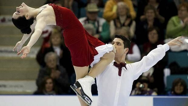 """Tessa Virtue and Scott Moir skate to gold in the senior dance competition, scoring 180.02 points skating to music from the musical """"Funny Face."""""""