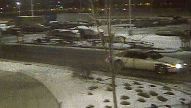 Airdrie RCMP are looking for a white Cadillac Deville that they believe may have been driven by the suspect in a shooting near CrossIron Mills mall.