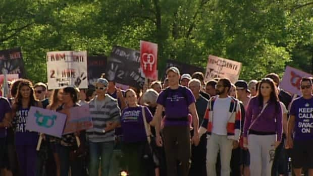 About 200 people marched on the grounds of Alberta legislature in support of Chevi Rabbit. Rabbit was assaulted last month after a group of men hurled homophobic slurs at him.