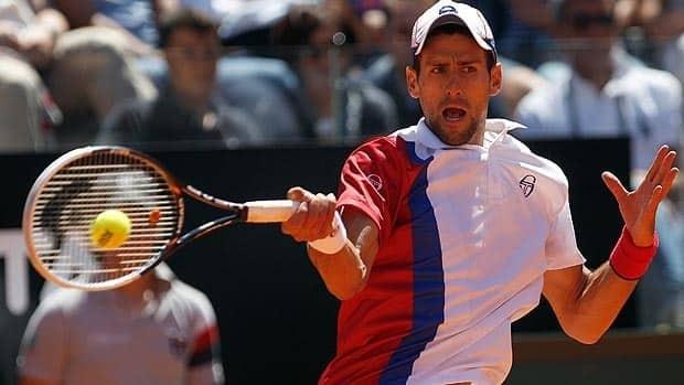 Novak Djokovic smacks a forehand during action Thursday against veteran Juan Monaco.