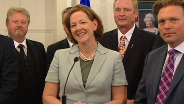 Alberta Premier Alison Redford speaks to reporters at Government House in Edmonton on Tuesday about her new cabinet.