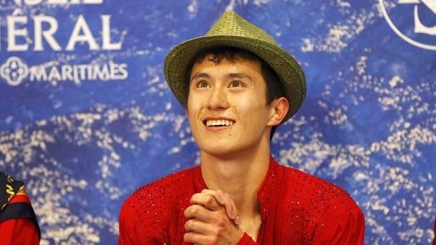 Patrick Chan reacts to his marks after Saturday's free skate in Nice, France.