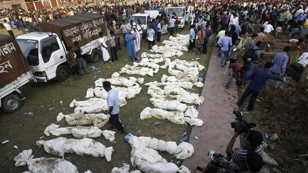 Bangladeshis prepare to bury the bodies of some victims of Saturday's fire in a garment factory in Dhaka, Bangladesh. Wal-Mart says the factory was making clothes for it without its knowledge.