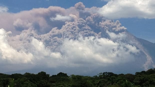 In this cellphone image, plumes of smoke rise from the Volcan de Fuego or Volcano of Fire as seen from Palin, south of Guatemala City, on Thursday.