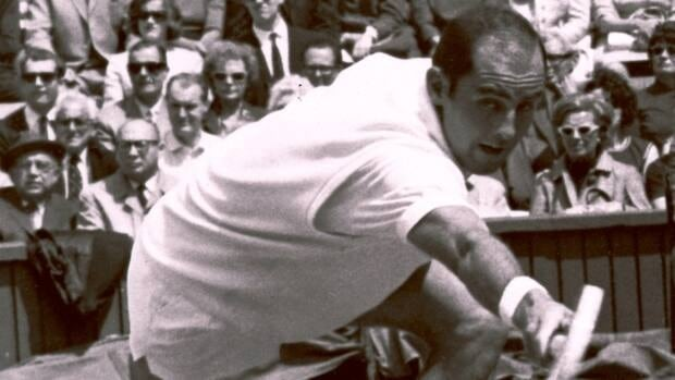 In this June 26, 1965, file photo, Bob Hewitt competes during a tennis match at Wimbledon, England. The Rhode Island-based International Tennis Hall of Fame has hired a Boston attorney to investigate allegations that one-time doubles champion Hewitt sexually abused underage girls he coached.