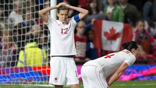 Canadian forwards Christine Sinclair, left, and Melissa Tancredi react after losing 4-3 in extra time in women's soccer action against the U.S. on Monday.