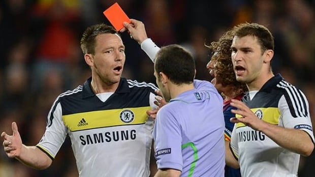UEFA banned Chelsea captain John Terry for three European club matches over his red card against Barcelona, seen here in April, in the Champions League semifinals.