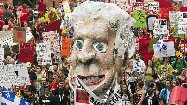 Thousands of students march through the streets of downtown Montreal with an effigy of Premier Jean Charest in a massive protest against tuition fee hikes on March 22, 2012.