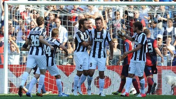 Mirko Vucinic (9) of Juventus FC celebrates with teammates after scoring on Sunday during their match in Genoa, Italy.