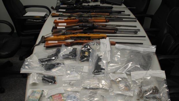 Police seized firearms, marijuana and cocaine as well as cash and loose gems from a Kam Lake area residence in Yellowknife Wednesday night.