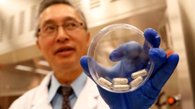 Dr. Thomas Louie, an infectious disease specialist at the University of Calgary, in his lab with stool pills in Calgary.