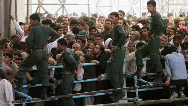 Members of Iran's Revolutionary Guards mark the anniversary of the country's late leader, Ayatollah Ruhollah Khomeini, in 2007. The elite unit is investigating the death of Mojtaba Ahmadi, not pictured, who is said to have led the country's cyberwar efforts.