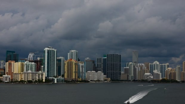 Downtown Miami is engulfed in storm clouds as tropical storm Karen heads toward Florida's Panhandle on Thurdsay. The storm threatened to become the first named tropical system to menace the United States this year.