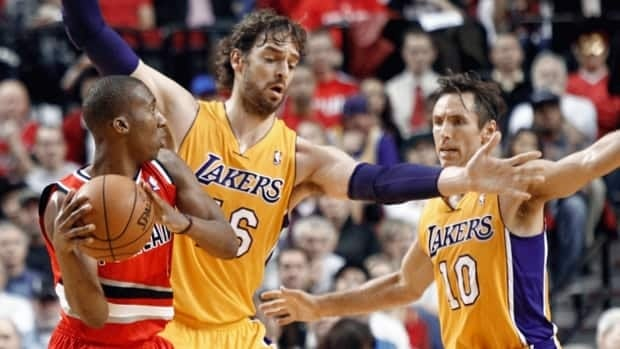 Portland Trail Blazers guard Nolan Smith, left, looks for help as Los Angeles Lakers' Pau Gasol, middle, and Steve Nash defend during first quarter action on Wednesday.