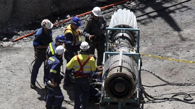 Mines rescue crew work on a gag machine, used to extract gases from mines, near the access portal of the Pike River coal mine near Greymouth on New Zealand's west coast November 30, 2010.
