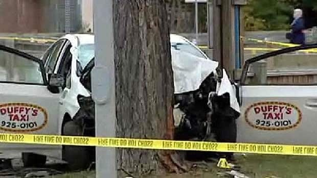 A Duffy's Taxi slammed into a tree on Beverley Street near Portage Avenue on Sept. 20, killing the passenger who was robbing the driver, police said.