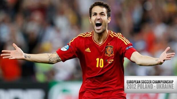 Spain's Cesc Fabregas celebrates what turned out to be the decisive shootout goal against Portugal during the European championship semifinal Wednesday in Donetsk, Urkaine.