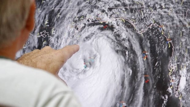 Senior hurricane specialist Stacy Stewart tracks Isaac at the National Hurricane Center in Miami on Tuesday. Forecasters warned that Isaac, especially if it strikes at high tide, could cause storm surges of up to 3.6 metres in some areas.