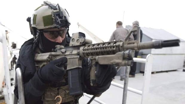 A member of the Canadian special forces unit JTF2 participates in a demonstration in Manitoba. Military documents say that a member of the JTF2 choked a subordinate nearly to death while in Afghanistan, but has never been tried in court for the 2005 incident.