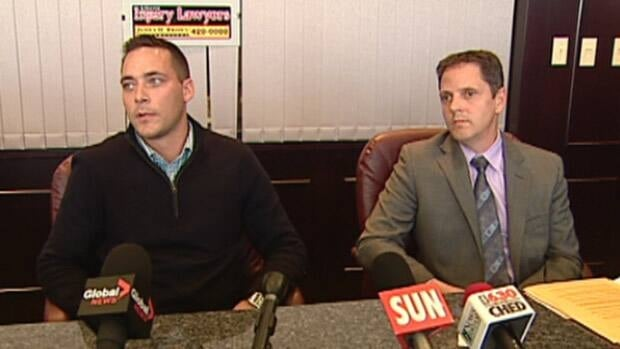 Matthew Harrison (left) and his lawyer, Richard Mallett, held a news conference in Edmonton on Wednesday.