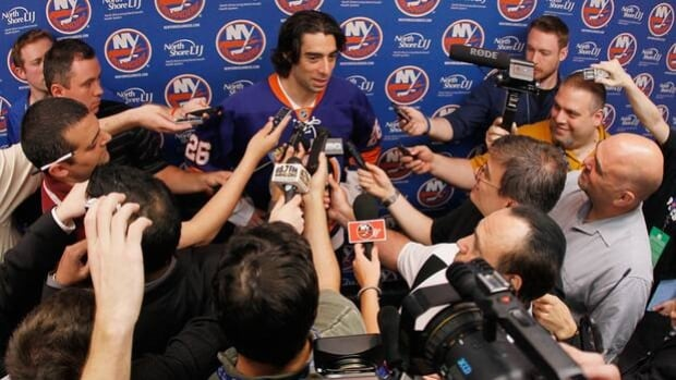 Forward Matt Moulson of the Islanders speaks to reporters at Nassau Coliseum on June 22.