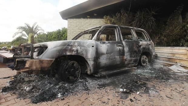 A burnt car is parked at the U.S. consulatein Benghazi, Libya, which was attacked and set on fire by gunmen on Monday.