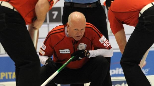 Skip Glenn Howard looks to his teammates as they bring the stone into the house during the men's semi-final game at the Capital One Canada Cup Curling action in Moose Jaw, Sask., on Saturday.