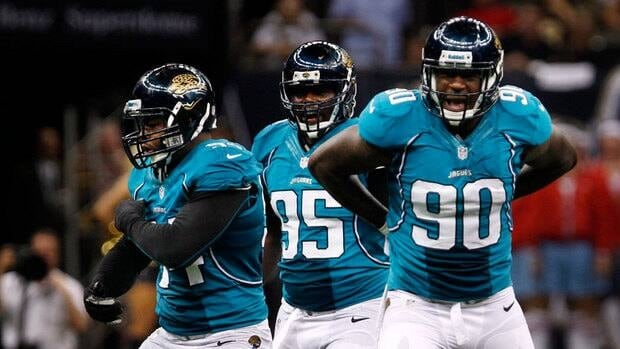 Jacksonville Jaguars defensive end Jeremy Mincey (94), defensive tackle D'Anthony Smith (95) and defensive end Andre Branch (90) celebrate after a sack in a preseason game this year.