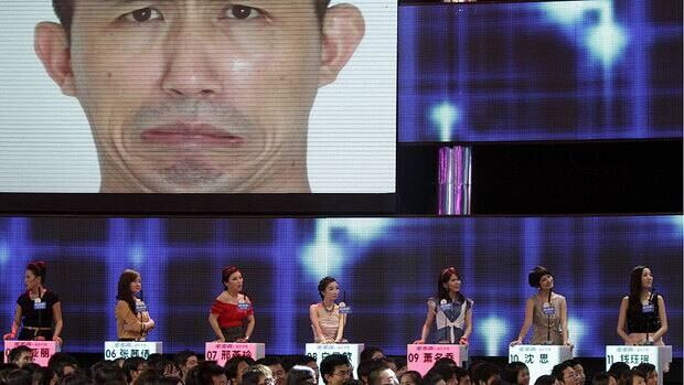 Contestants watch a video of a male contestant during the recording of an episode of the popular Chinese matchmaking show If You Are the One.