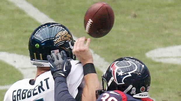 Jaguars quarterback Blaine Gabbert is hit and injured by the Texans' Danieal Manning on Sunday. An injured forearm and torn labrum in his left shoulder that requires surgery has ended Gabbert's season.