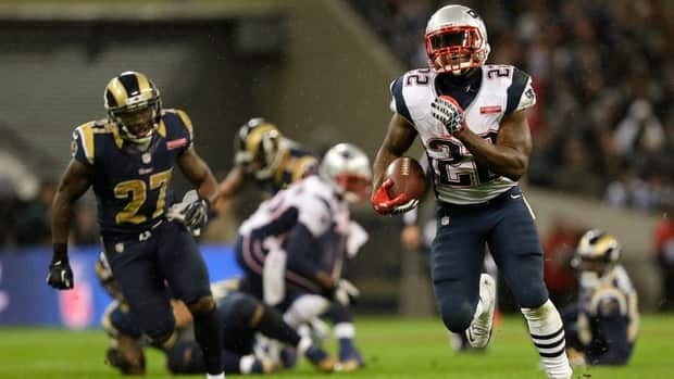 New England Patriots running back Stevan Ridley, right, takes off during the second half at Wembley Stadium in London on Sunday.