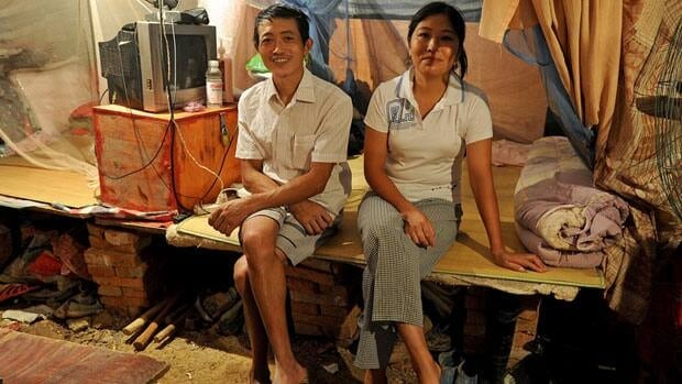 The Chinese leadership is under pressure to deal with the widening income gap between workers such as these migrant labourers, shown in August living in a tent near Hefei, and the more affluent elite.