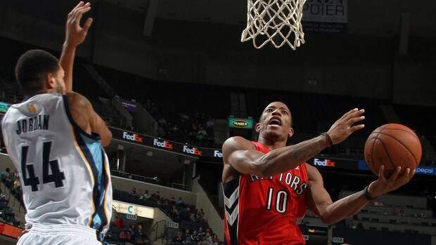 DeMar DeRozan, right, of the Toronto Raptors drives the basket against Jerome Jordan of the Memphis Grizzlies on Friday.