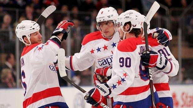 Alex Ovechkin, centre, of the Washington Capitals celebrates his first period goal with Dennis Wideman, left, Marcus Johansson and Dmitry Orlov against the New York Rangers on Saturday.
