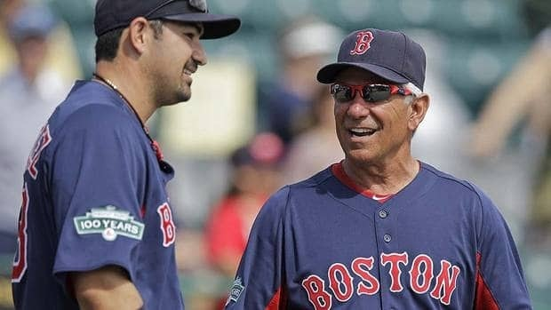 First baseman Adrian Gonzalez, left, is among several Red Sox who should provide offensive punch for new manager Bobby Valentine.