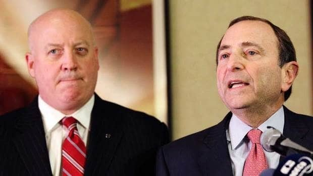 NHL Commissioner Gary Bettman, right, and deputy commissioner Bill Daly speak to reporters earlier this month.