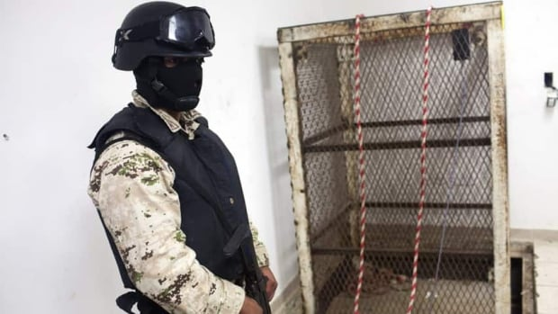 A Mexican army soldier stands next to an elevator shaft that lowers into a tunnel in the northern border city of Tijuana, Mexico Nov. 30, 2011.