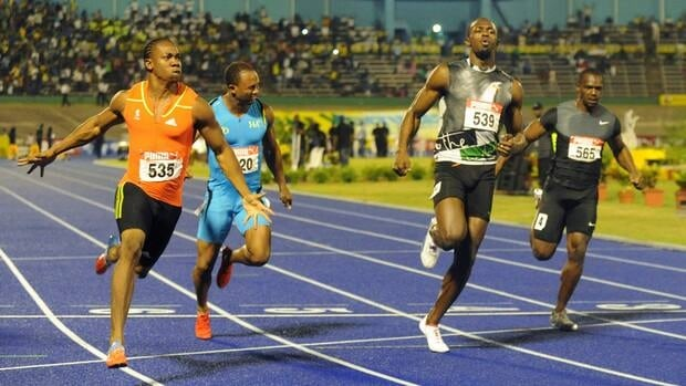 World champion Yohan Blake, left, celebrates after crossing the finish line ahead of current world-record holder Usain Bolt, second from right, on Friday night.