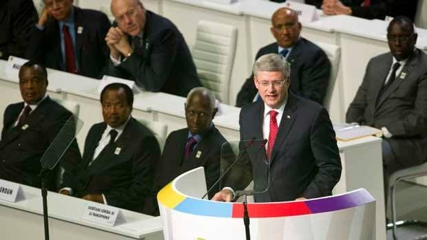Prime Minister Stephen Harper addresses the Francophonie Summit in Kinshasa on Saturday.
