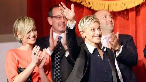 Entertainer Ellen DeGeneres, at right, waves as she is introduced at the 15th annual Mark Twain Prize for American Humor at the Kennedy Center in Washington on Monday. Her wife, actress Portia de Rossi, is seen at left.