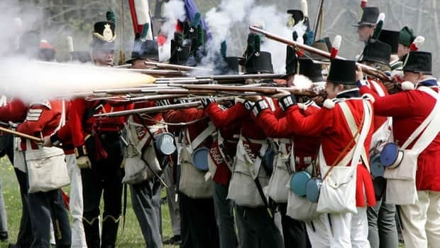 British soldiers fire their muskets at the American forces during a re-staging of the War of 1812 in 2007. The Harper government has hired a theatre expert to add a dash of war to the annual Canada Day celebrations on Parliament Hill this summer.