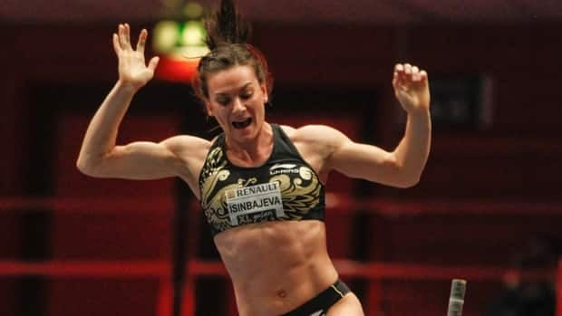 Yelena Isinbayeva of Russia reacts as she competes to win the women's pole vault on Thursday.
