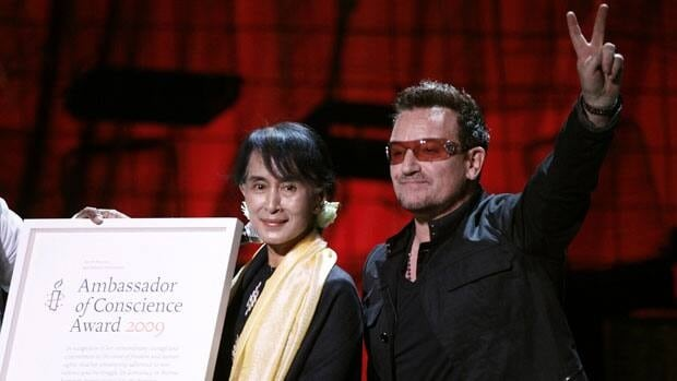 Aung San Suu Kyi  poses for a photograph with singer Bono after being awarded the Amnesty International Ambassador of Conscience Award in the Bord Gais Energy Theatre in Dublin.