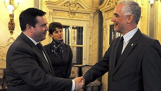 Immigration Minister Jason Kenney, left, is greeted by Hungary's Minister of Human Resources Zoltan Balog in Budapest on Oct. 8. Kenney raised the issue of Roma refugee claimants with Hungarian government officials during his visit.