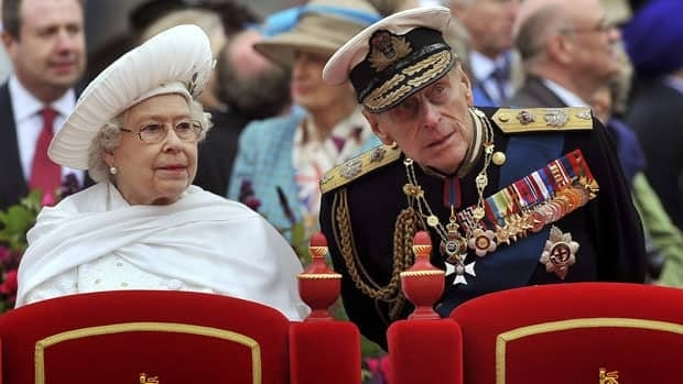 Queen Elizabeth speaks to Prince Philip on the Spirit of Chartwell during the Diamond Jubilee River Pageant on the River Thames on Sunday. The Duke of Edinburgh has since been hospitalized with a bladder infection.