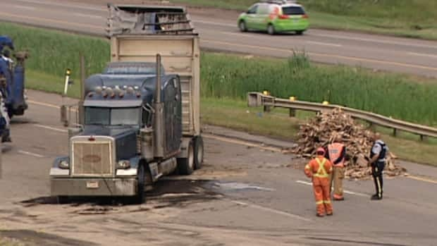 A tractor trailer rolled over on Highway 16 east of the city at Highway 216.