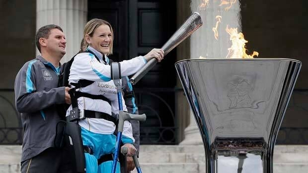 Claire Lomas lights the Paralympic flame in Trafalgar Square.