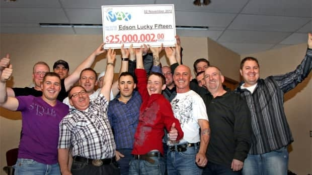 The winners of last week's Lotto Max draw hold up their presentation cheque on Friday.