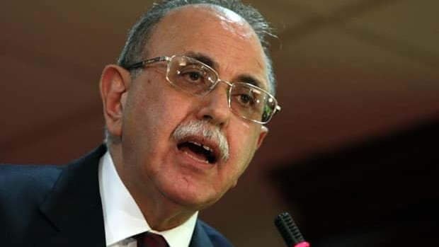 Libya's interim Prime Minister Abdurrahim el-Keib speaks during a press conference in Tripoli on April 25, 2012, where he accused the ruling National Transitional Council of hindering his government's efforts to hold elections for a constituent assembly on time.